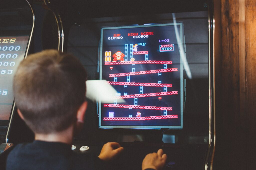 A kid playing Donkey Kong Arcade